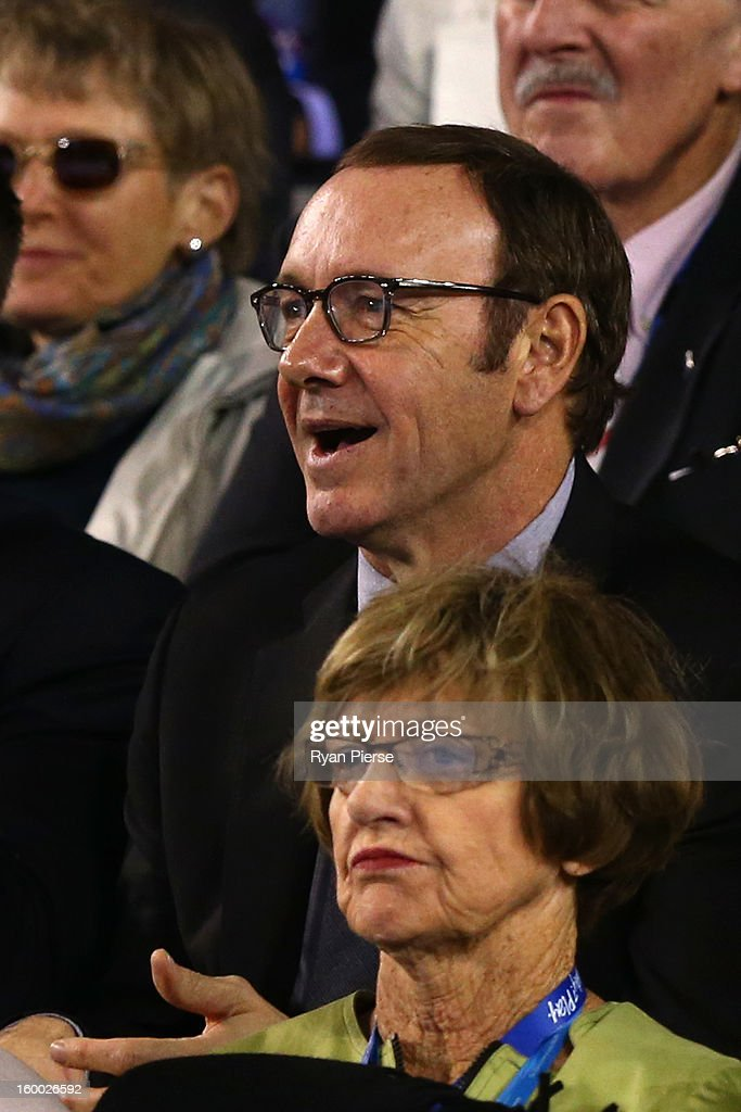 Actor Kevin Spacey and former tennis player Margaret Court watch Andy Murray of Great Britain and Roger Federer of Switzerland in their semifinal match during day twelve of the 2013 Australian Open at Melbourne Park on January 25, 2013 in Melbourne, Australia.