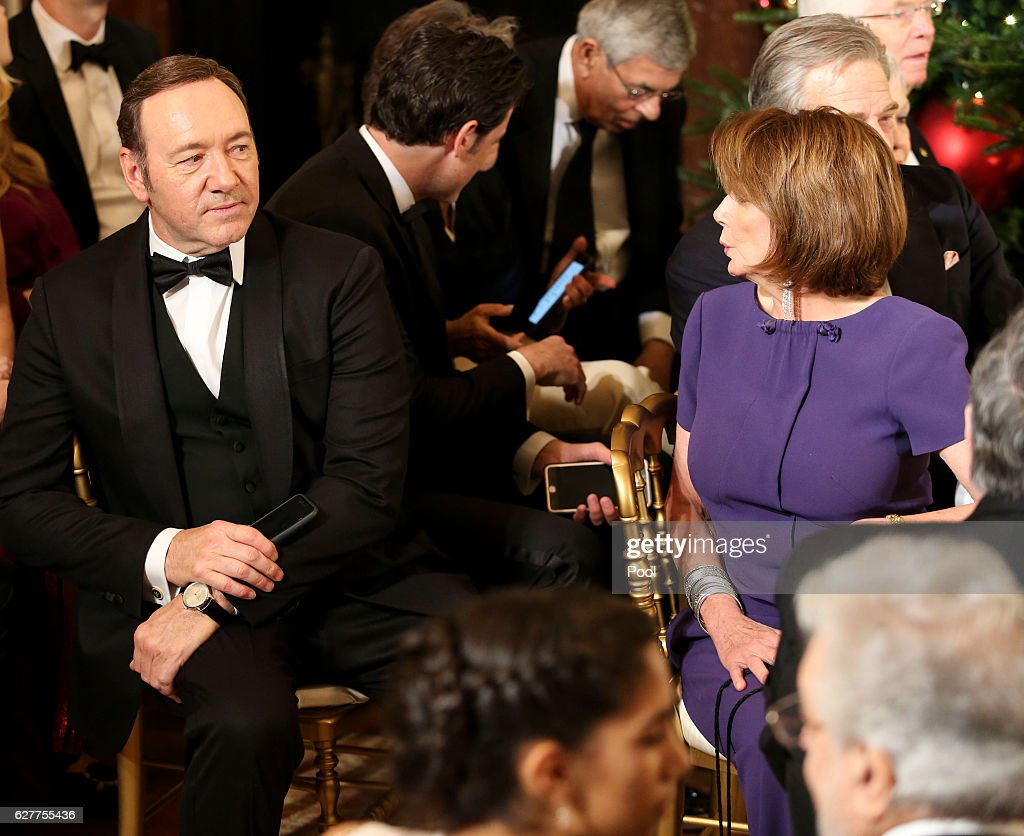 Actor Kevin Spacey and House Minority Leader Nancy Pelosi (D-CA) attend a ceremony for the 2016 Kennedy Center honorees December 4, 2016 in the East Room of the White House in Washington, DC. The honorees include Eagles band members, actor Al Pacino, singer James Taylor, pianist Martha Argerich and singer Mavis Staples.