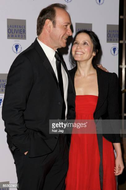 Actor Kevin Spacey and Singer Andrea Corr arrive at the Laurence Olivier Awards at the Grosvenor House on March 8 2009 in London England