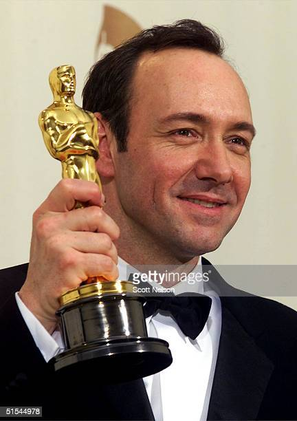 Actor Kevin Spacey holds his Oscar for Best Actor for his role in 'American Beauty' at the 72nd Annual Academy Awards in Los Angeles CA 26 March 2000...