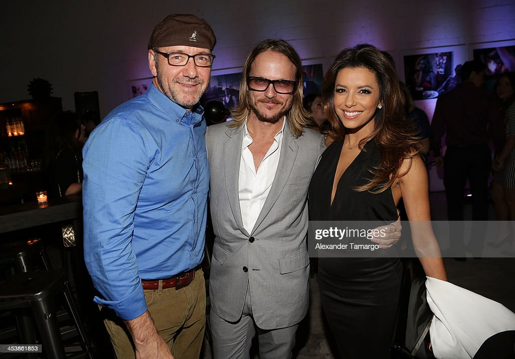 Actor Kevin Spacey, Photographer Randall Slavin, and Actress Eva Longoria attend Moments In Motion, An Exclusive Unveiling Of Never Before Seen Photos At De Nolet, Miami For Art Basel on December 5, 2013 in Miami, Florida.