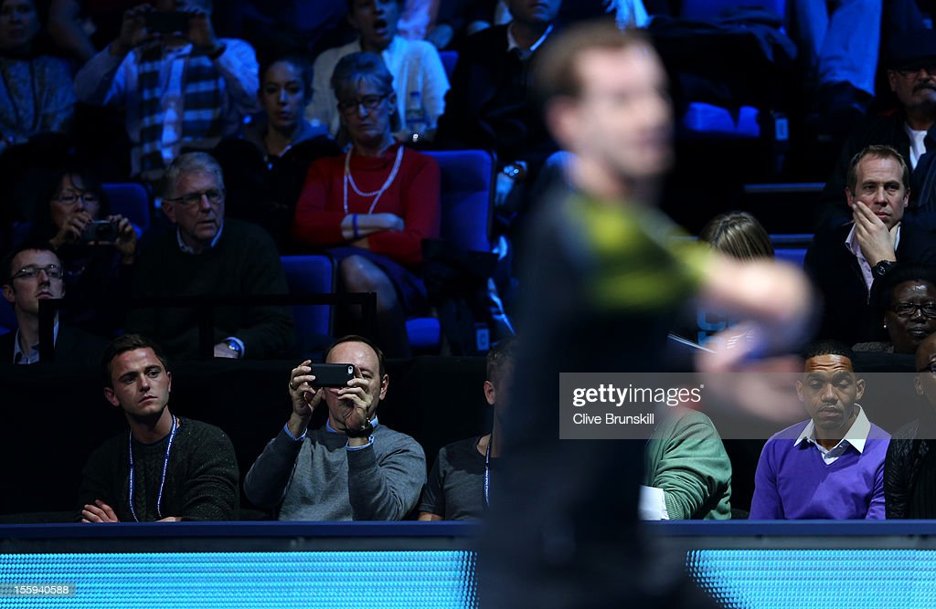 Actor Kevin Spacey takes a photograph of Andy Murray of Great Britain with his mobile phone during the men's singles match against Jo-Wilfried Tsonga of France on day five of the ATP World Tour Finals at O2 Arena on November 9, 2012 in London, England.