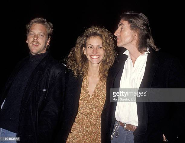 Actor Kiefer Sutherland actress Julia Roberts and director Joel Schumacher attend Sandy Gallin's 50th Birthday Party on May 27 1990 at Eureka Brewery...