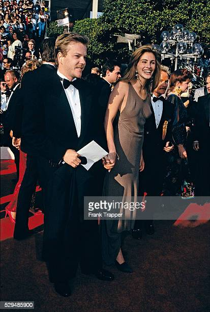 Actor Kiefer Sutherland and actress Julia Roberts arrive at the 1990 Academy Awards This photo appears on page 88 in Frank Trapper's RED CARPET book