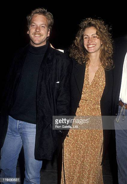 Actor Kiefer Sutherland and actress Julia Roberts attend Sandy Gallin's 50th Birthday Party on May 27 1990 at Eureka Brewery Restaurant in Los...