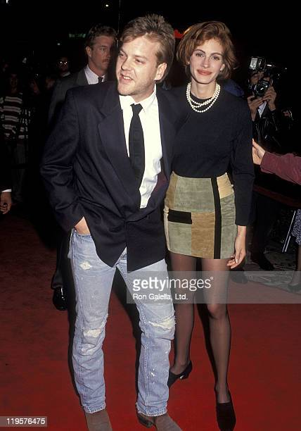 Actor Kiefer Sutherland and actress Julia Roberts attend the 'Sleeping with the Enemy' Westwood Premiere on February 4 1991 at Mann Village Theatre...
