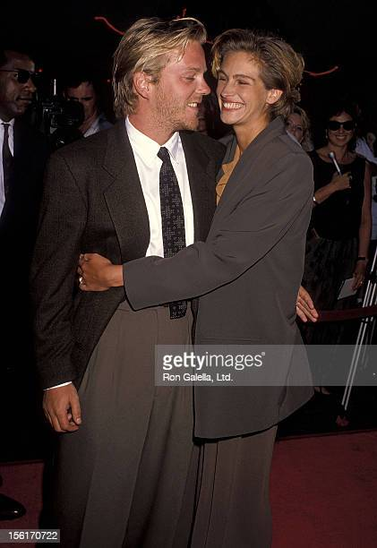 Actor Kiefer Sutherland and actress Julia Roberts attend the 'Young Guns II' Hollywood Premiere on July 30 1990 at Mann's Chinese Theatre in...