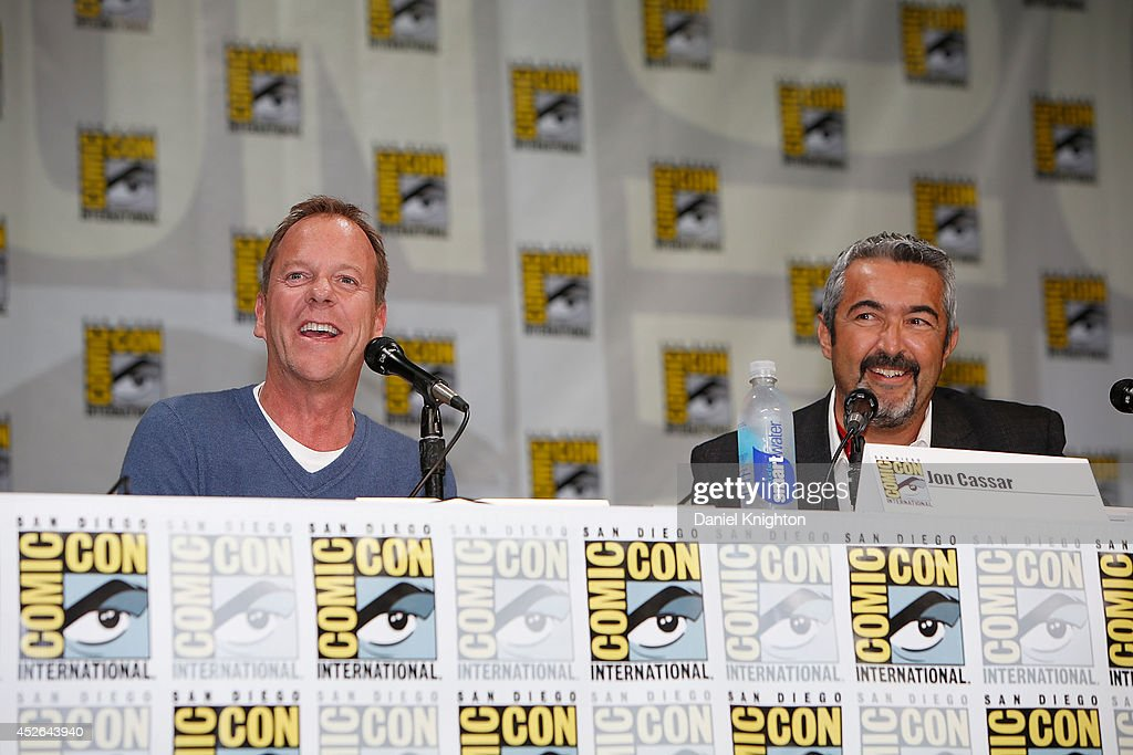 Actor Kiefer Sutherland (L) and producer/writer Jon Cassar attend the '24: Live Another Day' panel during Comic-Con International at San Diego Convention Center on July 24, 2014 in San Diego, California.