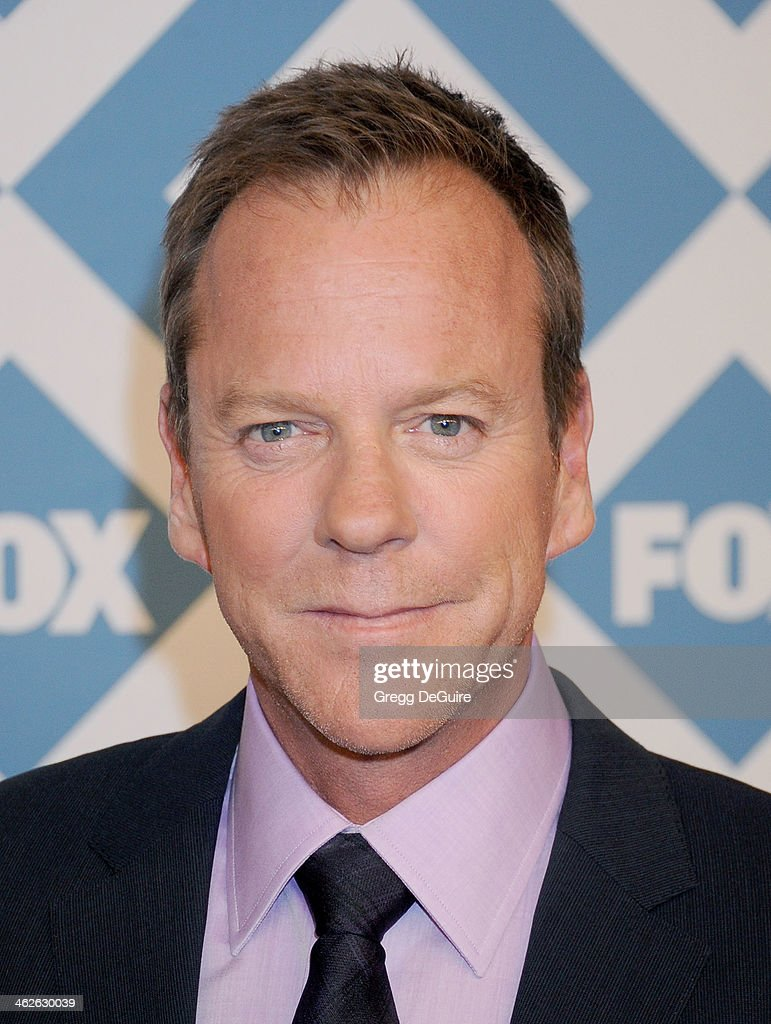 Actor Kiefer Sutherland arrives at the 2014 TCA winter press tour FOX all-star party at The Langham Huntington Hotel and Spa on January 13, 2014 in Pasadena, California.