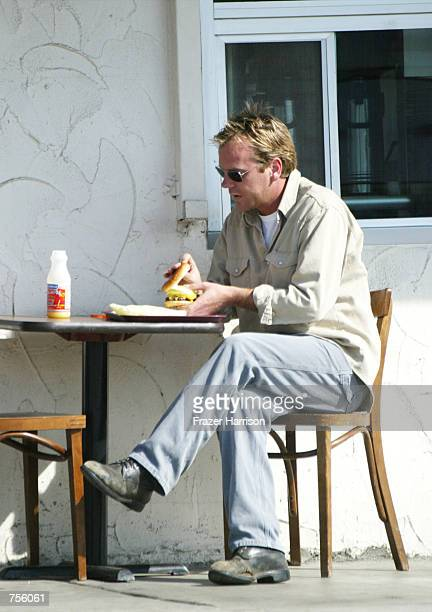 Actor Kiefer Sutherland eats a sandwich at the Sunset Grill March 5 2002 in West Hollywood CA