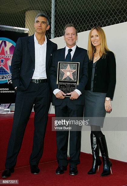 Actor Kiefer Sutherland poses with Fox Entertainment executives Peter Liguori and Dana Walden at the ceremony honoring Sutherland with a star on the...