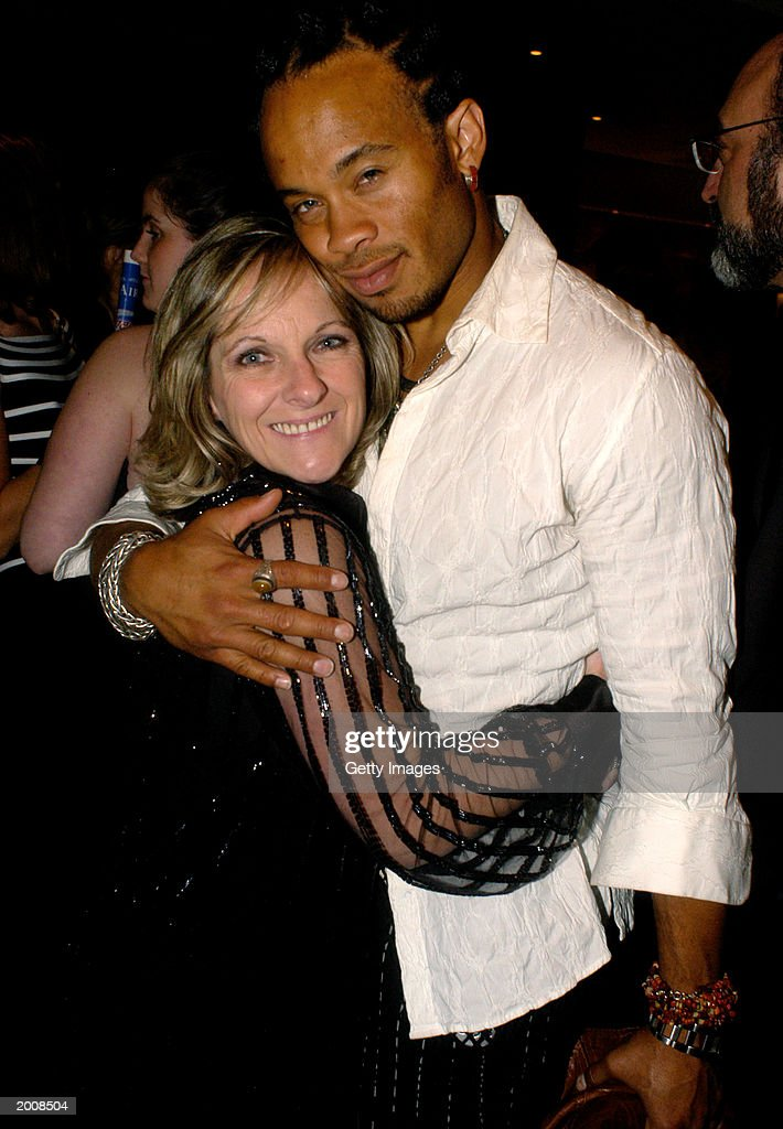 Actor Kiko Ellsworth is hugged by a female companion at the after party for the 30th Annual Daytime Emmy Awards at the Sea Grill Restaurant May 16, 2003 in New York City.