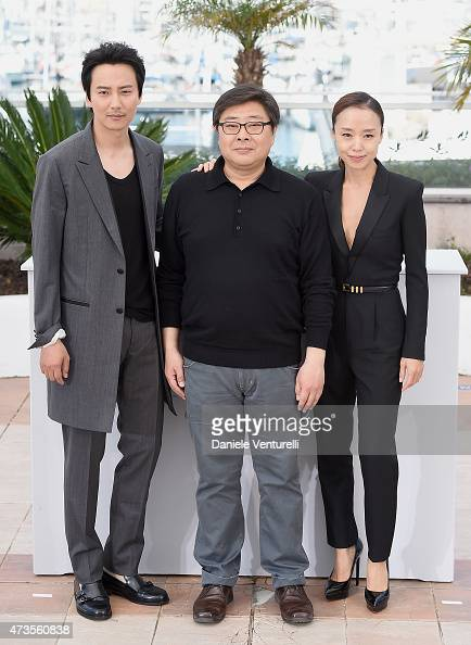 Actor Kim Nam Gil director Oh Seung Uk and actress Jeon Doyeon attends the 'MuRoeHan The Shameless' Photocall during the 68th annual Cannes Film...
