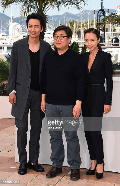 Actor Kim Namgil director Oh SeungUk and actress Jeon Doyeon attend a photocall for 'MoeRoeHan The Shameless' during the 68th annual Cannes Film...