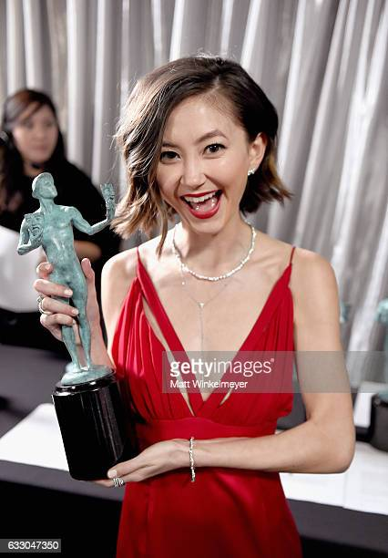 Actor Kimiko Glenn winner of the Outstanding Ensemble in a Comedy Series award of 'Orange Is the New Black' pose in the press room during The 23rd...