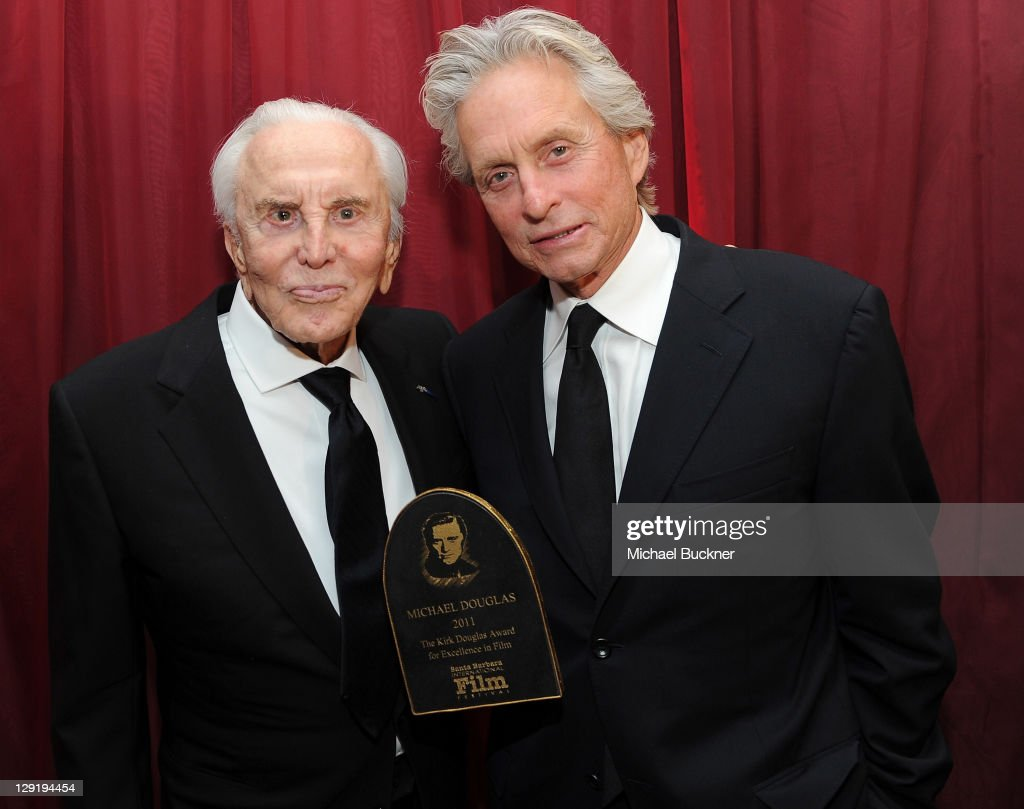 Actor Kirk Douglas (L) and actor Michael Douglas attend SBIFF's 2011 Kirk Douglas Award for Excellence In Film honoring Michael Douglas at the Biltmore Four Seasons on October 13, 2011 in Santa Barbara, California.