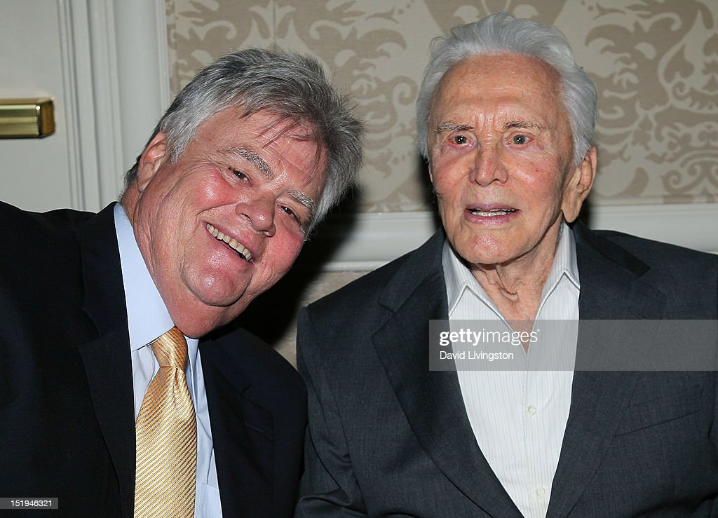 Actor Kirk Douglas (R) and son producer Joel Douglas attend the Los Angeles Mission's 20th Anniversary Gala for the Anne Douglas Center for Women at the Four Seasons Hotel Los Angeles at Beverly Hills on September 12, 2012 in Beverly Hills, California.