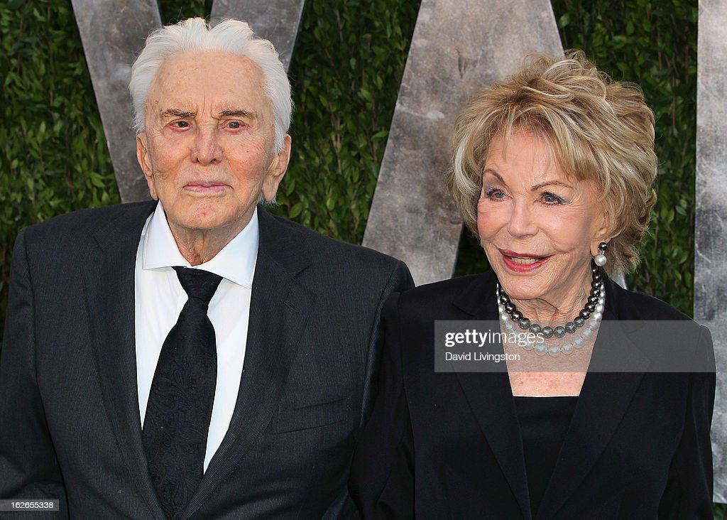 Actor Kirk Douglas (L) and wife Anne Douglas attend the 2013 Vanity Fair Oscar Party at the Sunset Tower Hotel on February 24, 2013 in West Hollywood, California.