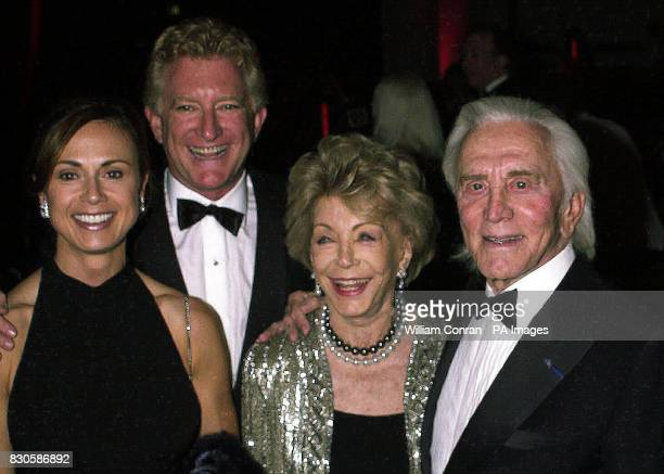 Actor Kirk Douglas with his wife Anne and oldest son Peter with his wife Lisa attend the annual John Wayne Cancer Institute's Odyssey Ball at the...