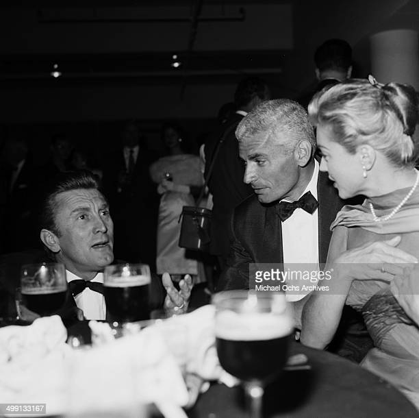 Actor Kirk Douglas with Jeff Chandler and Esther Williams attend a dinner party in Los Angeles California