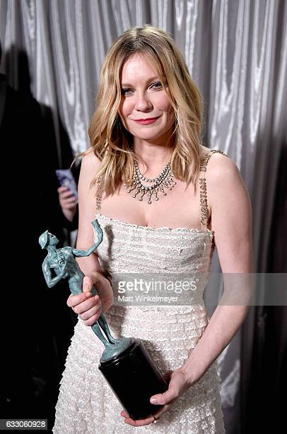 Actor Kirsten Dunst winner of the Outstanding Cast in a Motion Picture award for 'Hidden Figures' poses backstage with award during The 23rd Annual...