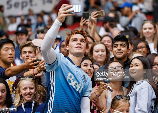 Actor KJ Apa takes a selfie with fans after the Legends And Stars Whitecaps FC Charity Alumni match at BC Place on September 16 2017 in Vancouver...