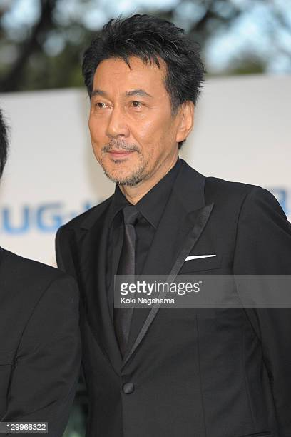 Actor Koji Yakusho poses on the green carpet during the Tokyo International Film Festival Opening Ceremony at Roppongi Hills on October 22 2011 in...