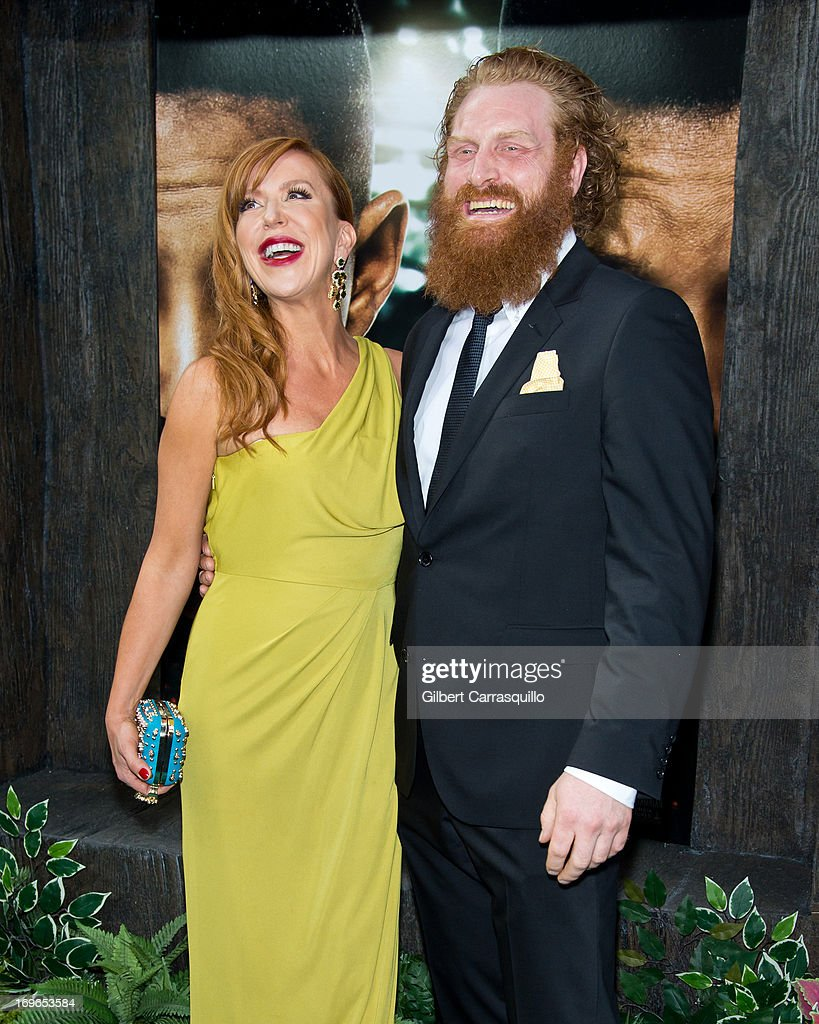 Actor Kristofer Hivju (R) and guest attend the 'After Earth' premiere at Ziegfeld Theater on May 29, 2013 in New York City.