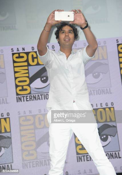 Actor Kunal Nayyar takes a photo as he walks onstage at ComicCon International 2017 'The Big Bang Theory' panel at San Diego Convention Center on...