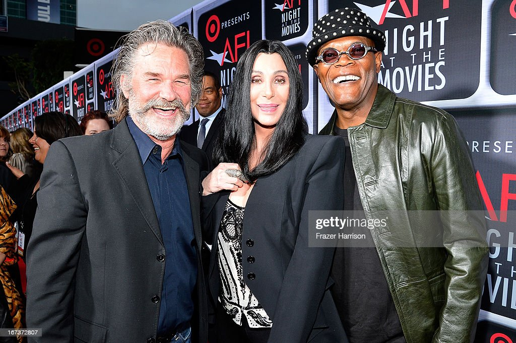 Actor <a gi-track='captionPersonalityLinkClicked' href=/galleries/search?phrase=Kurt+Russell&family=editorial&specificpeople=206294 ng-click='$event.stopPropagation()'>Kurt Russell</a>, singer/actress Cher, and actor <a gi-track='captionPersonalityLinkClicked' href=/galleries/search?phrase=Samuel+L.+Jackson&family=editorial&specificpeople=167234 ng-click='$event.stopPropagation()'>Samuel L. Jackson</a> arrive on the red carpet for Target Presents AFI's Night at the Movies at ArcLight Cinemas on April 24, 2013 in Hollywood, California.