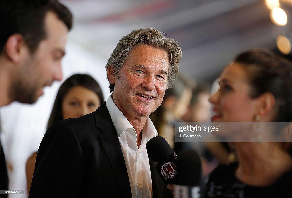 Actor Kurt Russell speaks to the media at the premiere of 'The Art of Steal' at Roy Thomson Hall on September 11 2013 in Toronto Canada