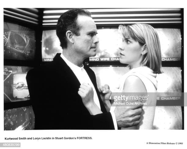 Actor Kurtwood Smith and actress Loryn Locklin in a scene from the movie 'Fortress' circa 1992