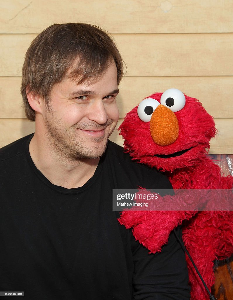 Actor Kyle Bornheimer and Elmo attend the PBS SoCal Kids Event at the Jim Henson Company Studios on January 28 2011 in Hollywood California
