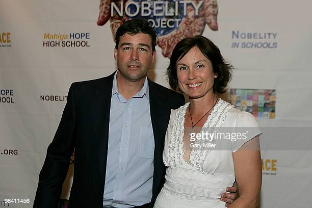 Actor Kyle Chandler and his wife Kathryn Chandler pose on the red carpet for the Nobelity Project's dinner honoring country music legend Willie...