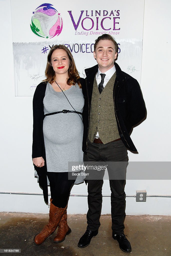 Actor <a gi-track='captionPersonalityLinkClicked' href=/galleries/search?phrase=Kyle+Gallner&family=editorial&specificpeople=572459 ng-click='$event.stopPropagation()'>Kyle Gallner</a> and his wife arrive at Linda's Voice live art auction at LAB ART Gallery on February 16, 2013 in Los Angeles, California.