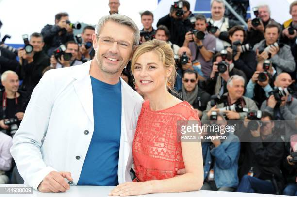 Actor Lambert Wilson and actress Anne Consigny pose at 'Vous N'avez Encore Rien Vu' Photocall during the 65th Annual Cannes Film Festival at Palais...