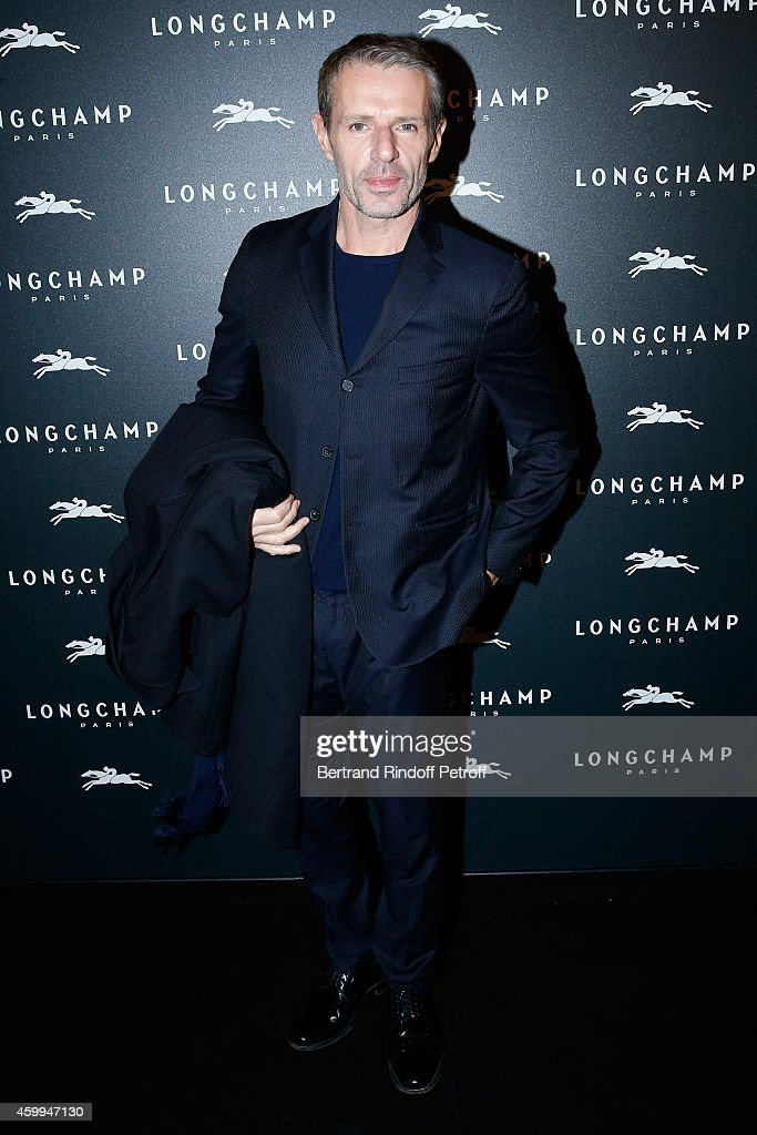 Actor <a gi-track='captionPersonalityLinkClicked' href=/galleries/search?phrase=Lambert+Wilson&family=editorial&specificpeople=626933 ng-click='$event.stopPropagation()'>Lambert Wilson</a> attends the Longchamp Elysees 'Lights On Party' Boutique Launch on December 4, 2014 in Paris, France.
