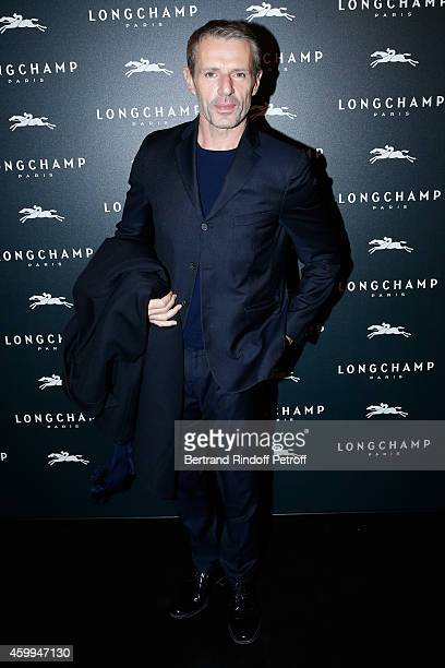 Actor Lambert Wilson attends the Longchamp Elysees 'Lights On Party' Boutique Launch on December 4 2014 in Paris France
