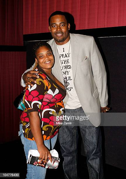 Actor Lamman Rucker poses with a fan after the premiere screening of 'NSecure' at Atlantic Station on September 30 2010 in Atlanta Georgia