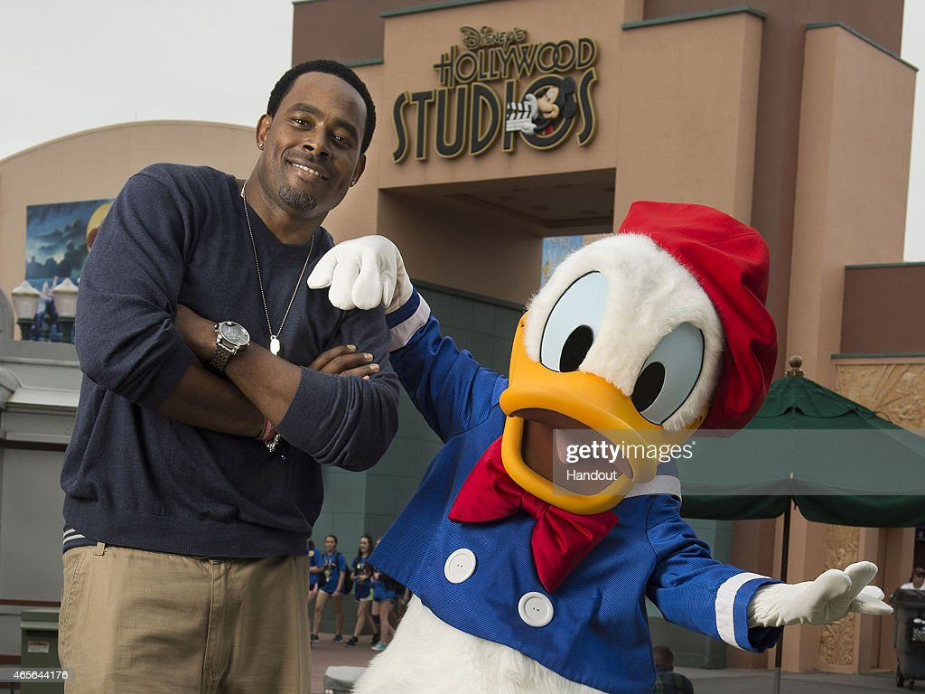 Actor Lamman Rucker poses with Donald Duck during the Disney Dreamers Academy weekend at Walt Disney World Resort on March 06, 2015 in Lake Buena Vista, Florida. The eighth annual event takes place from March 5-8, 2015 and is a career-inspiration program for 100 distinguished high school students across the United States.
