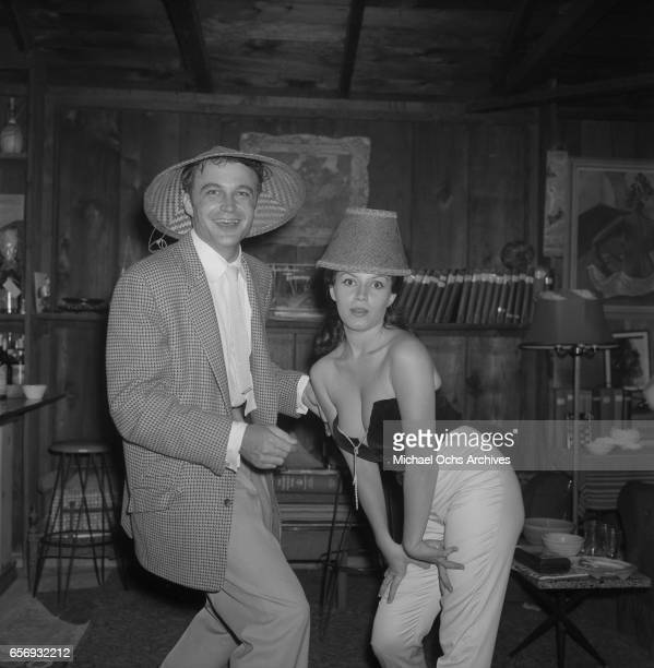 Actor Lance Fuller and actress Joan Bradshaw attend a party in honor of Playboy Magazine founder and publisher Hugh Hefner on June 26 1957 in Los...