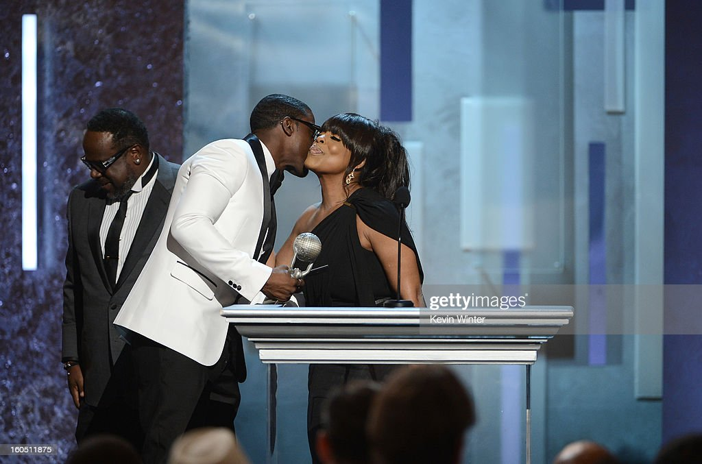 Actor Lance Gross (C) accepts Outstanding Supporting Actor in a Comedy Series award for 'Tyler Perry's House of Payne' from actors Cedric the Entertainer (L) and Niecy Nash (R) onstage during the 44th NAACP Image Awards at The Shrine Auditorium on February 1, 2013 in Los Angeles, California.
