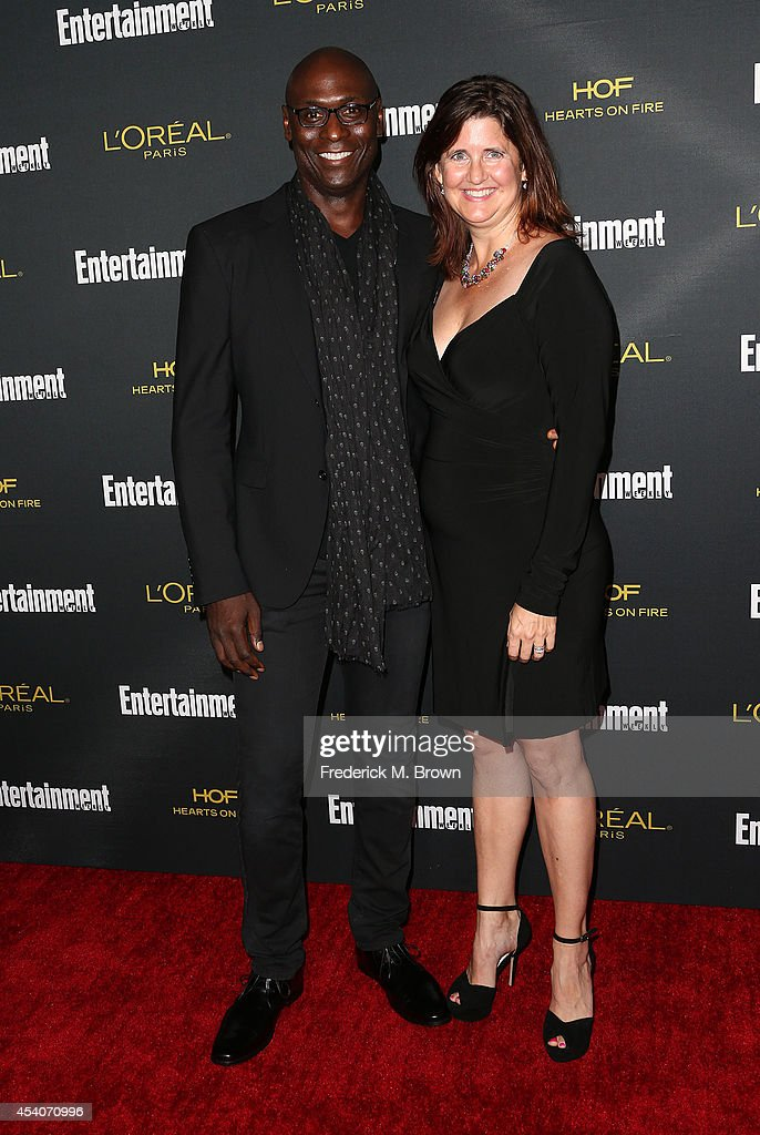 Actor Lance Reddick (L) and his guest attend Entertainment Weekly's Pre Emmy Party at the Fig & Olive Melrose Place on August 23, 2014 in West Hollywood, California.