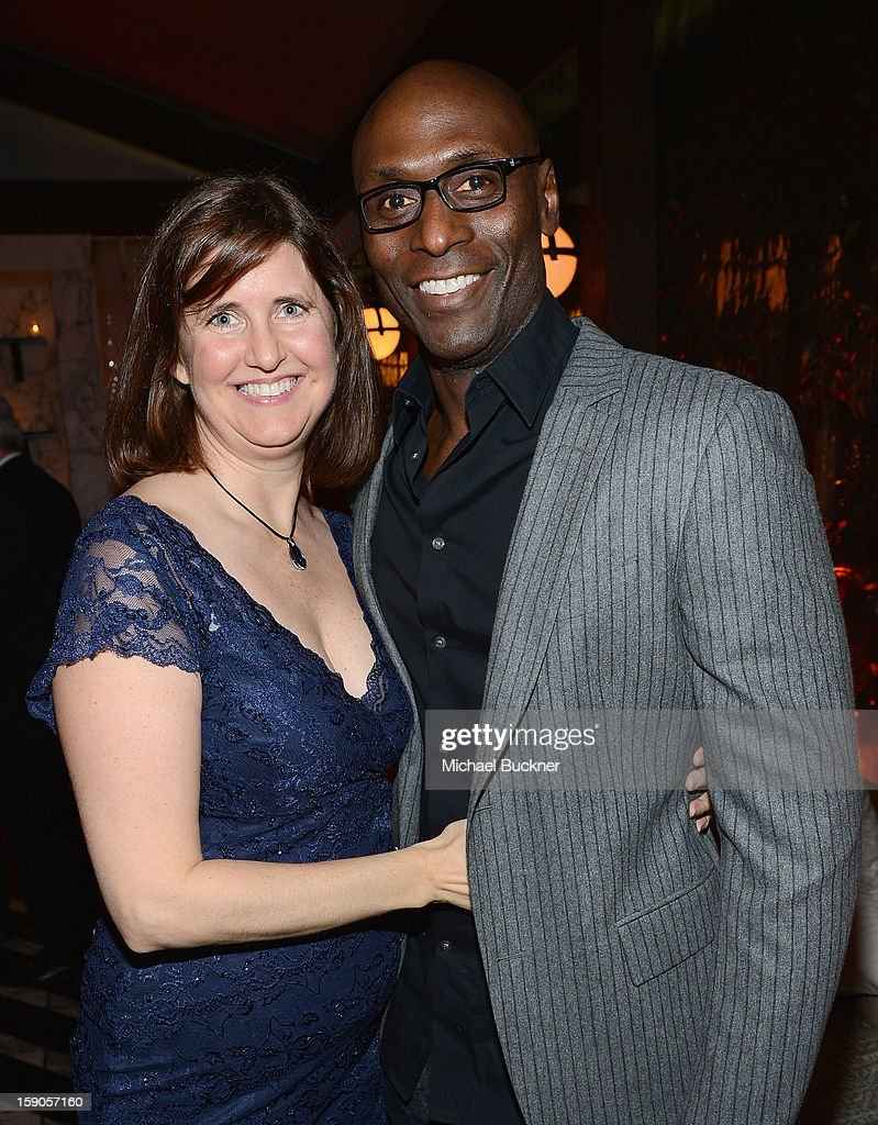 Actor Lance Reddick (R) and Stephanie Reddick attend the Audi Golden Globes Kick Off 2013 at Cecconi's Restaurant on January 6, 2013 in Los Angeles, California.