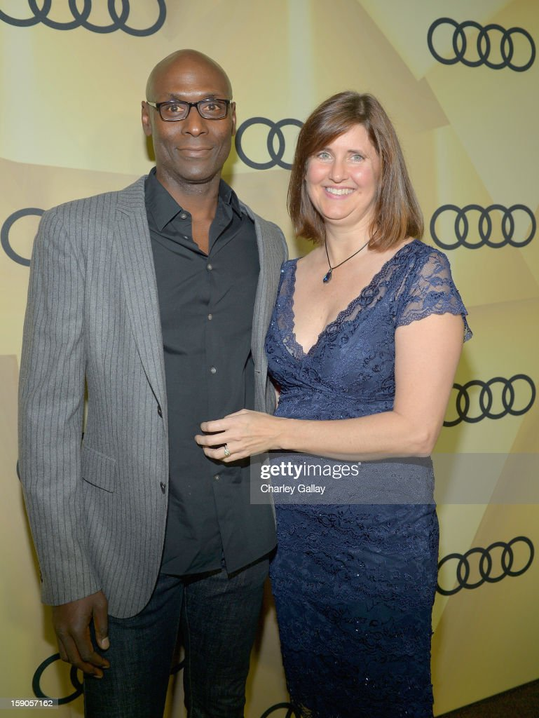 Actor Lance Reddick (L) and Stephanie Reddick attend the Audi Golden Globes Kick Off 2013 at Cecconi's Restaurant on January 6, 2013 in Los Angeles, California.