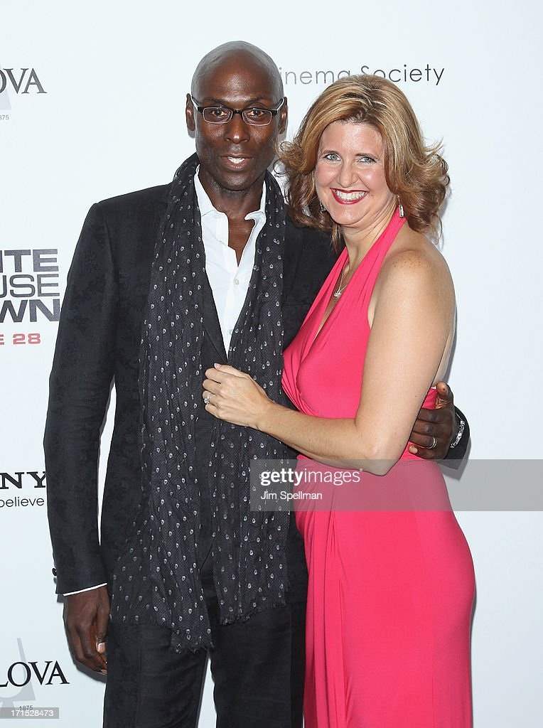 Actor Lance Reddick (L) and wife attend 'White House Down' New York Premiere at Ziegfeld Theater on June 25, 2013 in New York City.