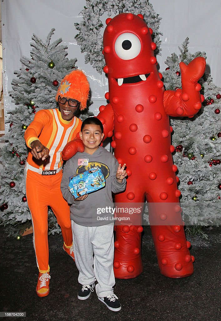 Actor Lance Robertson aka DJ Lance Rock (L) and guest attend the Los Angeles Mission's Christmas Eve for the homeless at the Los Angeles Mission on December 24, 2012 in Los Angeles, California.