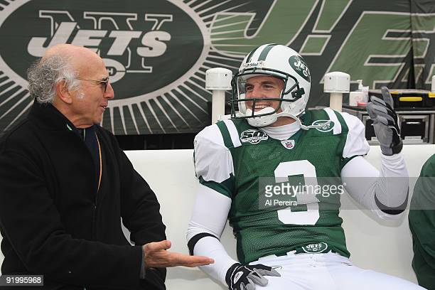 Actor Larry David and Kicker Jay Feely of the New York Jets share a laugh on the New York Jets sideline before the Buffalo Bills and New York Jets...