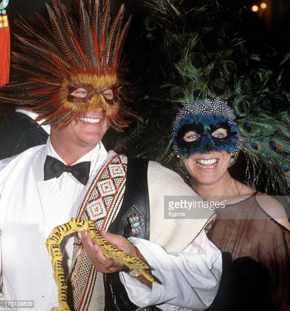 Actor Larry Hagman and his wife Maj at a masked ball circa 1990