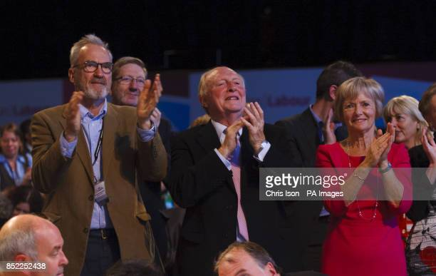 Actor Larry Lamb and Lord and Lady Kinnock applaud Labour Party leader Ed Miliband during his speech at the Labour Party annual conference at The...